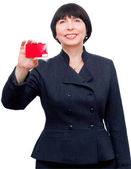 Mature smiling business woman holding a credit card — Stock Photo