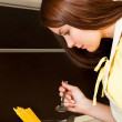 Stock Photo: Beautiful wompreparing spaghetti in kitchen