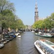 Canal boat with tourists sails in Amsterdam canal, Holland — Stock Video