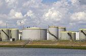 Oil silos along a canal — Stock Photo