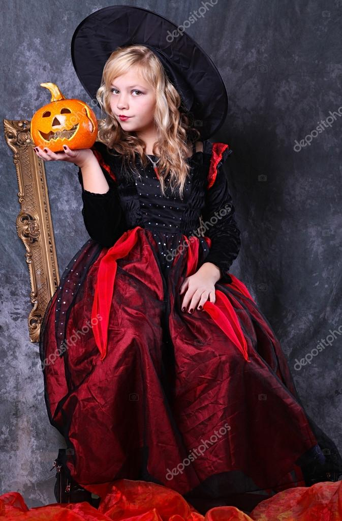 Girl with a Halloween pumpkin   Photo #13757951