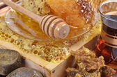 Fresh honeycombs and wooden stick ,cup of Turkish tea,propolis, — Stock Photo