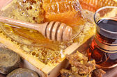 Fresh honeycombs and wooden stick ,cup of Turkish tea,propolis — Stock Photo