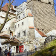 Stock Photo: Visitors admire the Bran Castle, also called Dracula's Castle