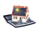 House with solar panels and sunlight rays — Stock Photo