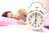 Women and alarm clock — Stock Photo
