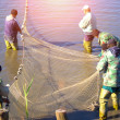 Stock Photo: Pulling a Fishing Net