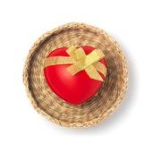 Cuore rosso con nastro dorato in un cestino — Foto Stock