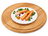 Sausage on a white plate — Stock Photo