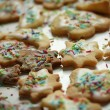 Cookies with frosting on white table — Stock Photo
