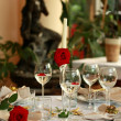 Stock Photo: Restaurant table with glasses and rose