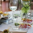 Restaurant table with glasses and flowers — Stock Photo #16234399