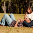Stock Photo: Young Couple In Love Lay On Grassy Field
