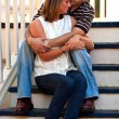 Stock Photo: Young Couple In Love Embrace On Gazebo Steps