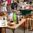 Shoppers Look Through Merchandise At City Garage Sale — Stock Photo #12539664