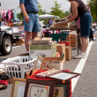 Stock Photo: Senior MLooks Over Merchandise At Garage Sale