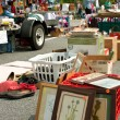 Stock Photo: Bargain Hunters Look Over Merchandise At City Garage Sale