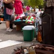 Female Vendor Gets Merchandise Ready At Garage Sale — Stock Photo #12540411