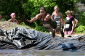 Woman Dives Into Mud Pit On Obstacle Course Run — Stock Photo