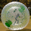 Girl Rolls Inside Large Zorb — Stock Photo