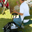 Stock Photo: Artist Paints On Canvas At Outdoor Festival