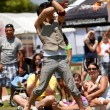Постер, плакат: Circus Performer Twirls Ropes Of Fire At Outdoor Festival