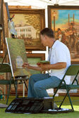 Artist Works On Painting At Outdoor Festival — ストック写真