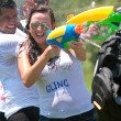 Squirt Others And Get Squirted In Water Gun Fight - Stock Photo