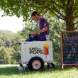 Stock Photo: Ice Cream Vendor Waits For Customers In Park