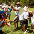 Drench One Another In Group Water Gun Fight - Stock Photo