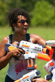 Woman Gets Squirted In Face With Water Gun — Stock Photo