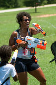 Woman Squirts Other In Water Gun Fight — Stock Photo