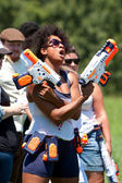 Woman Defiantly Brandishes Weapons Just Before Water Gun Fight — Stock Photo