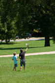 Man And Boy Fly Model Airplane in Park — Stock Photo