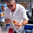 MCompetes In Hot Dog Eating Contest — Stock Photo #13689550