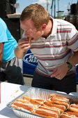 Young Man Competes In Hot Dog Eating Contest — Stock Photo