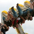 Постер, плакат: Teens Get Turned Upside Down On Carnival Ride