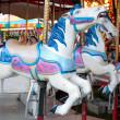 Stock Photo: Closeup Of Carousel Horses At County Fair