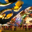 Stock Photo: Colorful Lights Of Carnival Rides Motion Blur At Fair