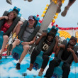 Stock Photo: Teenagers Laugh On Scary Carnival Ride