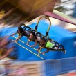 Teenagers Enjoy A Flying Carnival Ride With Motion Blur — Stock Photo