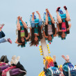 Постер, плакат: Teens Go Upside Down On Carnival Ride