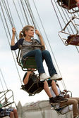 Adult Woman Rides Swings At County Fair — Stock Photo