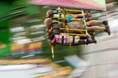 Motion Blur Of On Speedy Carnival Ride — Stock Photo