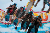 Teenagers Laugh On A Scary Carnival Ride — Stock Photo