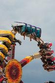 Teens Enjoy Inverted Carnival Ride At Fair — Stock Photo