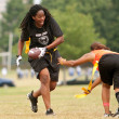 Stock Photo: Female Flag Football Player Avoids Defender