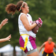 Female Flag Football Player Catches Pass - Stock Photo