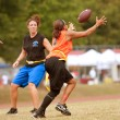 Female Flag Football Player Catches A Pass - Stock Photo