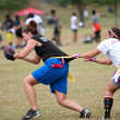 Female Flag Football Player Gets Grabbed By Defender — Stock Photo